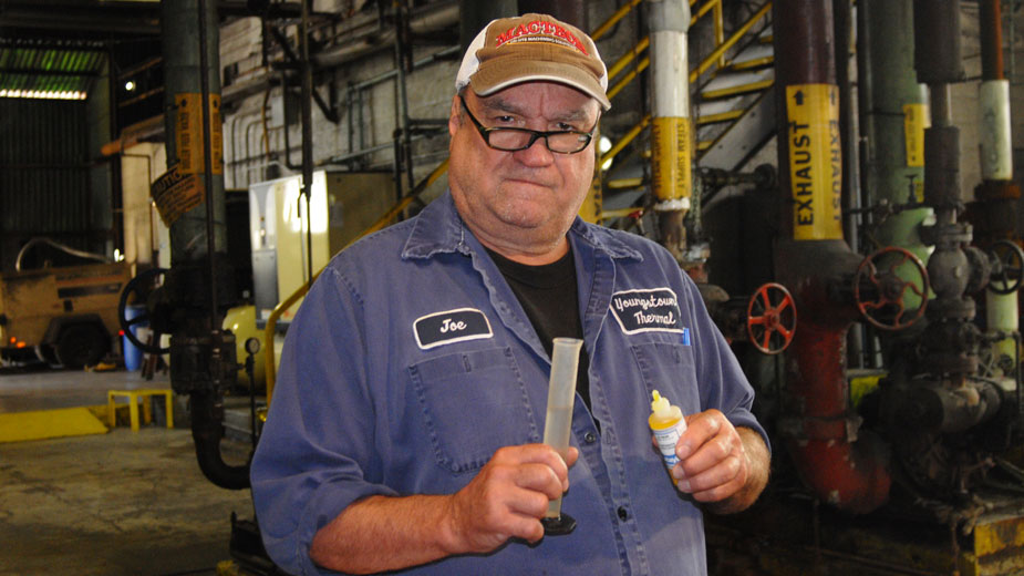 Joe Firmstone tests a water sample at the Youngstown Thermal North Avenue plant.