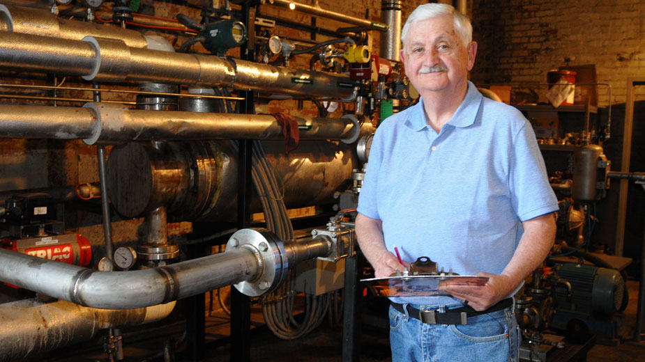 John Rambo, general manager, stands beside Youngstown Thermal's renewable fuel preheat system.