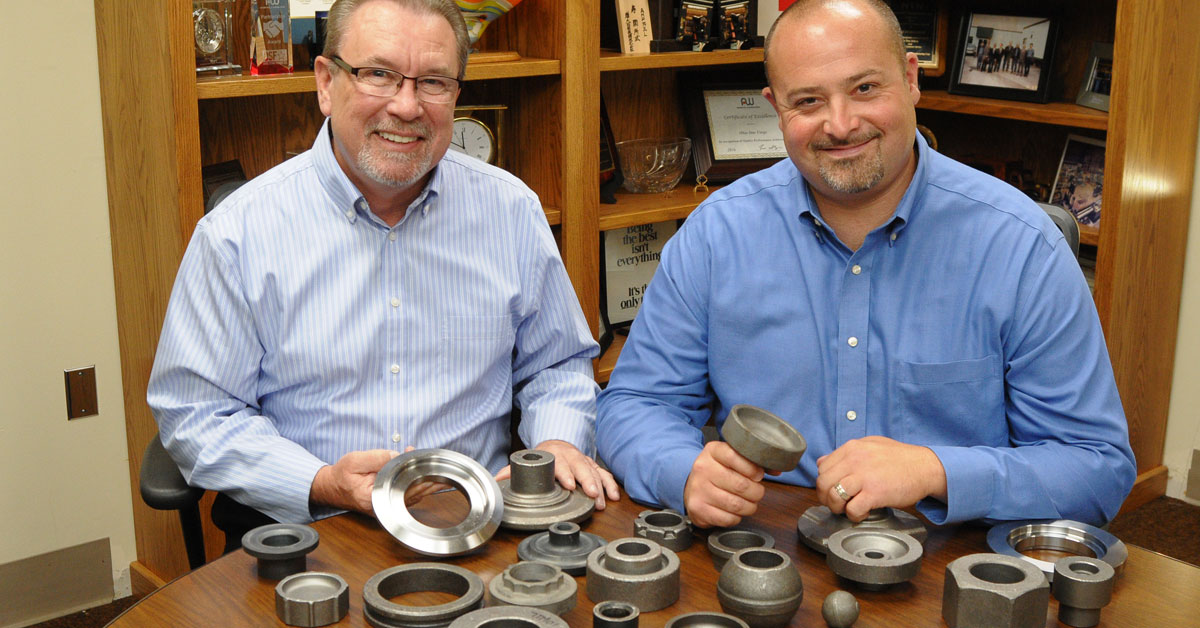 William Orbach, president and CEO, and Carl Paglia, director of sales, show bearing and transmission components that Ohio Star Forge produces